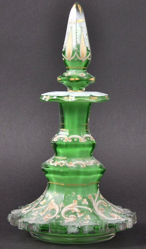 A 19TH CENTURY BOHEMIAN GREEN GLASS SCENT BOTTLE AND ST