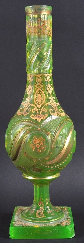 A 19TH CENTURY BOHEMAIN GREEN GLASS VASE engraved and d