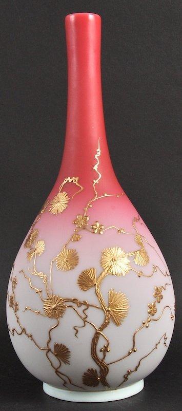 A WEBBS TYPE BULBOUS PEACH GLASS VASE enamelled with gi