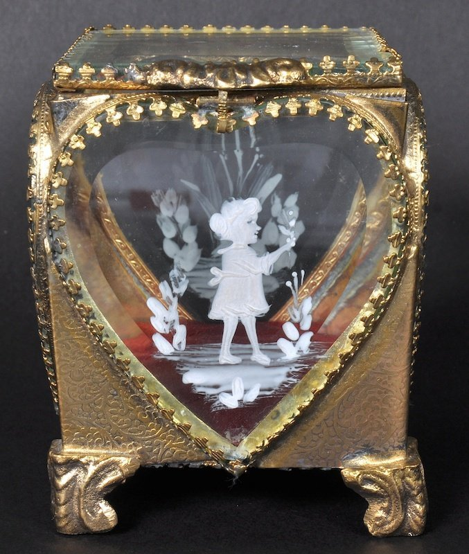A MARY GREGORY TYPE BOX, gilt frame painted with a pan