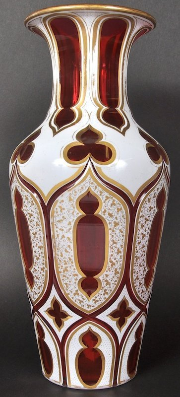 A GOOD BOHEMIAN RUBY GLASS WHITE OVERLAY VASE. 14ins lo