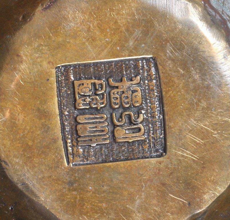 A BRONZE FOUR FACED BUDDHA HEAD.   - 2