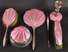 A SILVER AND PINK ENAMEL SIX PIECE DRESSING TABLE SET
