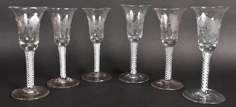 A NEAR SET OF SIX 18TH CENTURY WINE GLASSES with upturn