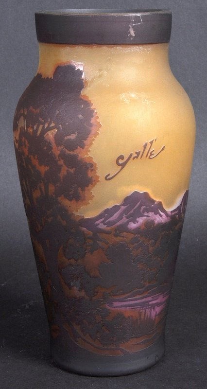 A GALLE CAMEO VASE decorated with a mountainous scene.