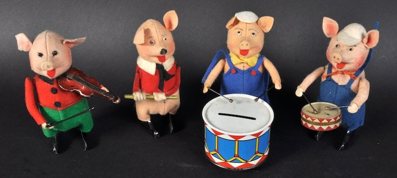 A SCHUCO TINPLATE FOUR PIECE PIG ORCHESTRA, playing bi