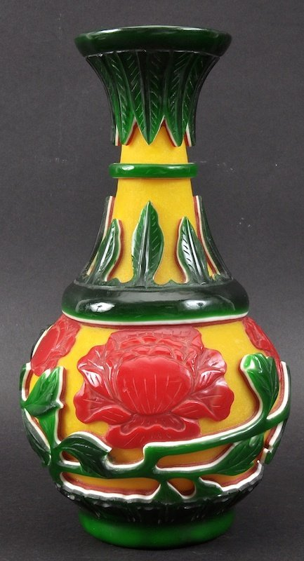 A CHINESE BEIJING YELLOW GLASS VASE decorated with foli