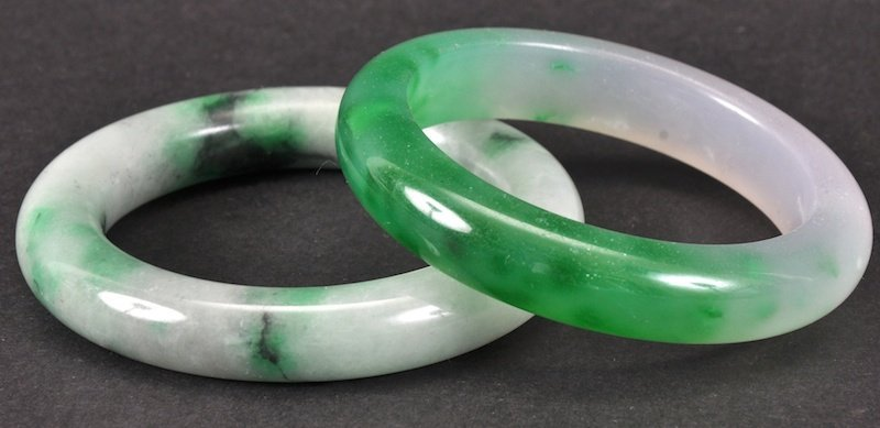 A CHINESE GREEN JADE CIRCULAR BANGLE together with a th