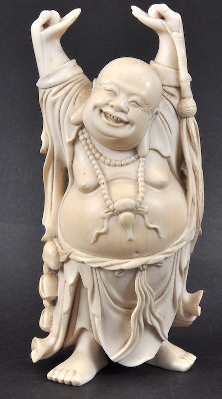 A 19TH CENTURY CHINESE CARVED IVORY FIGURE OF A BUDDHA