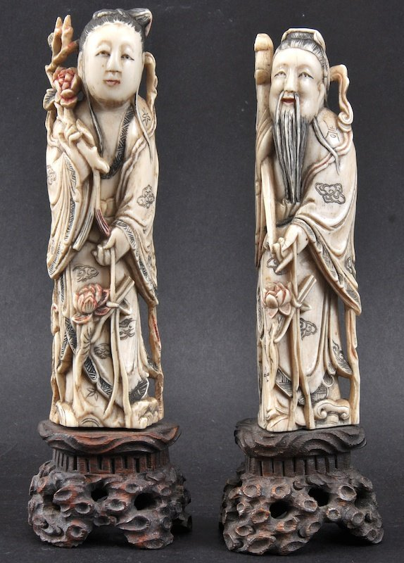 A PAIR OF LATE 19TH CENTURY CHINESE CARVED IVORY FIGURE