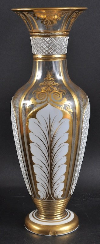 A BOHEMIAN WHITE OVERLAY AND GILT VASE.  13.5ins high.