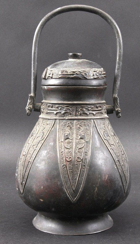 A 19TH CENTURY CHINESE BRONZE WINE VESSEL AND COVER