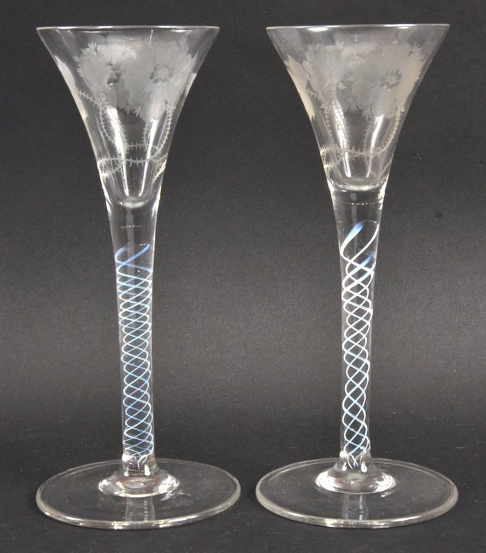 A MATCHING PAIR OF FLUTED WINE GLASSES.
