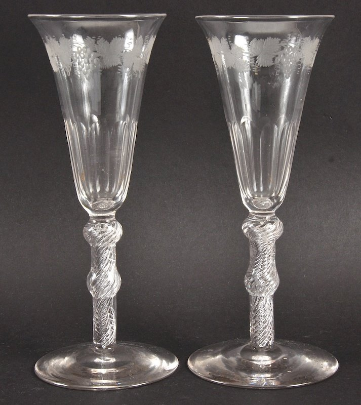 A PAIR OF GEORGIAN FLUTED WINE GLASSES, the bowls