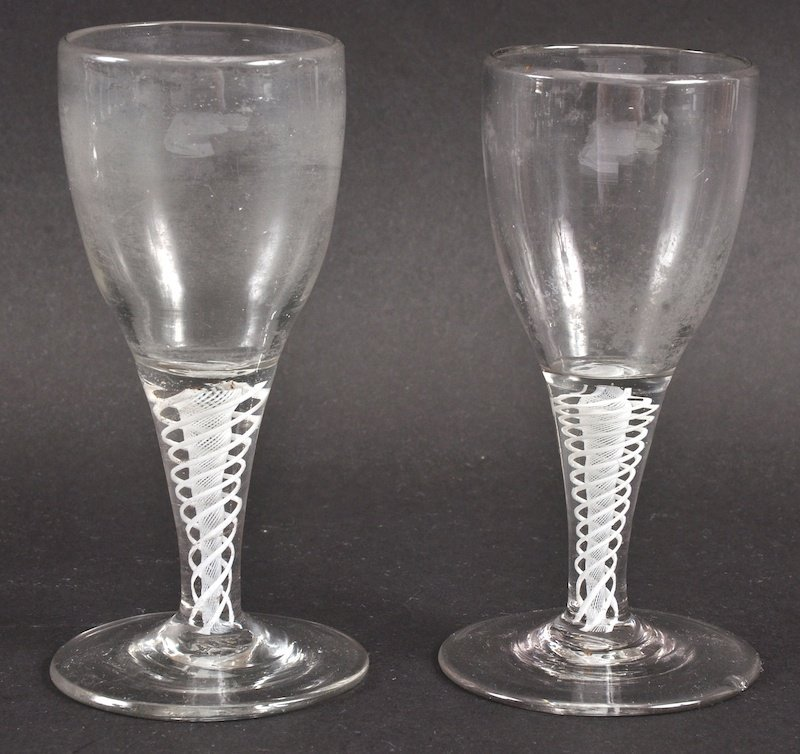 A PAIR OF GEORGIAN WINE GLASSES with plain bowls and