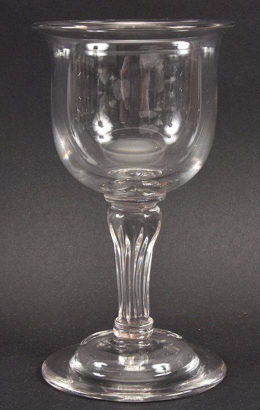 A PLAIN HEAVY GEORGIAN GOBLET with fluted stem and