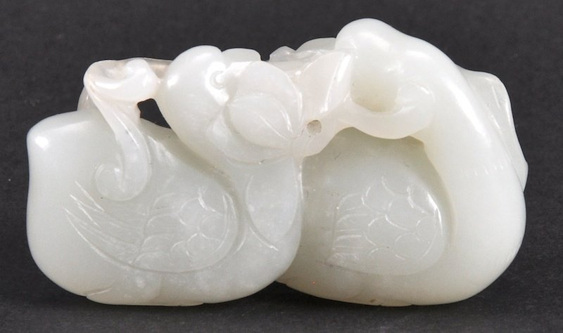 AN 18TH CENTURY CHINESE CARVED WHITE JADE FIGURE