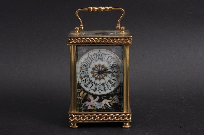 A FRENCH BRASS AND PORCELAIN CARRIAGE CLOCK with