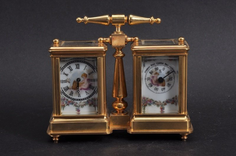 A FRENCH BRASS AND PORCELAIN COMBINED CARRIAGE CLOCK