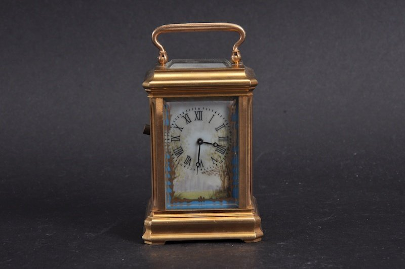 A FRENCH BRASS CARRIAGE CLOCK with painted SEVRES TYPE