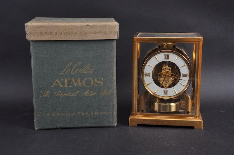 A LE COULTRE ATMOS CLOCK, 9ins high in original box.