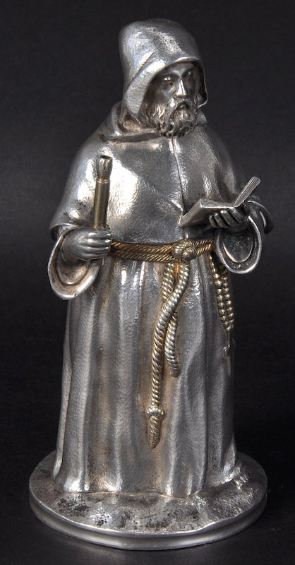 A RUSSIAN SILVER FIGURE OF A MONK in his robe, open