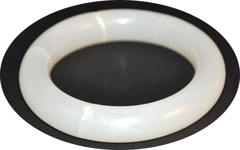 AN EARLY 20TH CENTURY CHINESE WHITE JADE CIRCULAR