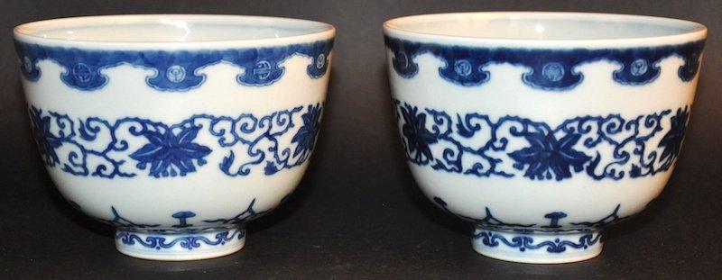 A PAIR OF CHINESE BLUE AND WHITE CIRCULAR BOWLS bearing
