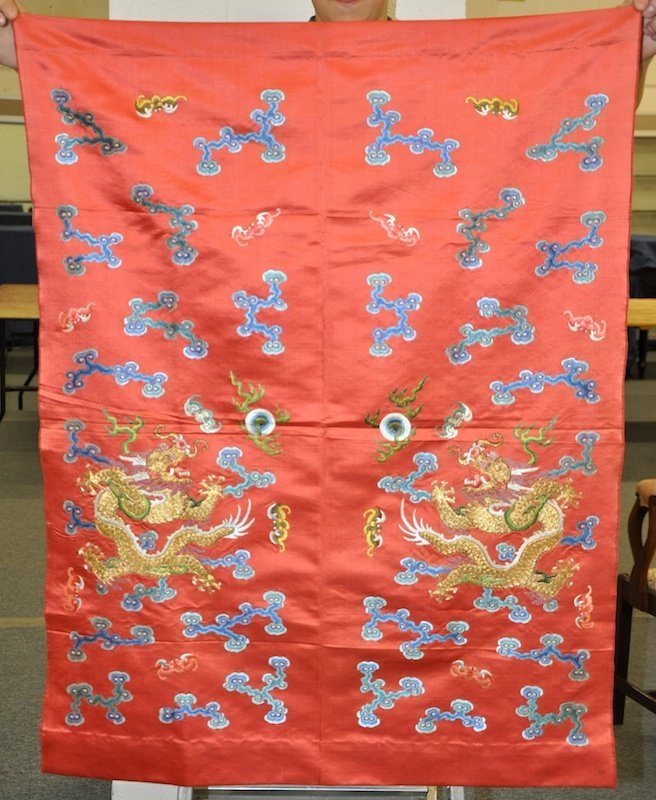 AN EARLY 20TH CENTURY CHINESE RED GROUND SILK PANEL