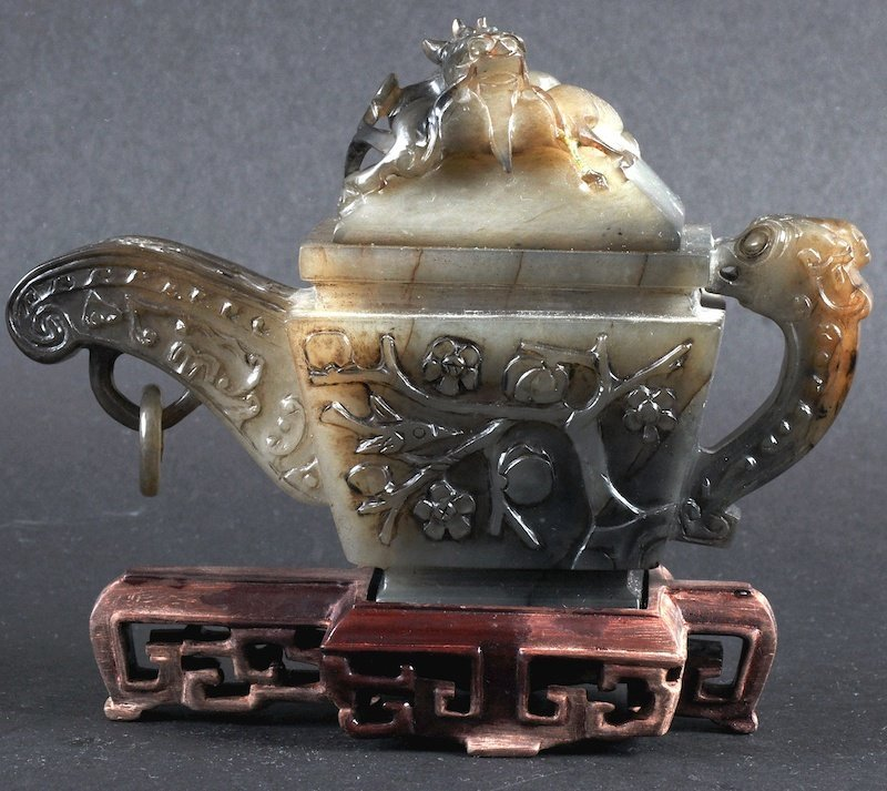 AN EARLY 20TH CENTURY CHINESE MUTTON JADE TEAPOT AND CO