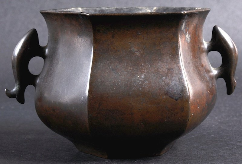 A CHINESE QING DYNASTY TWIN HANDLED BRONZE CENSER beari