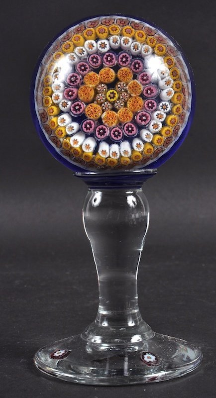 A GOOD MILLEFIORI PAPERWEIGHTS on a STAND.  7.5ins high