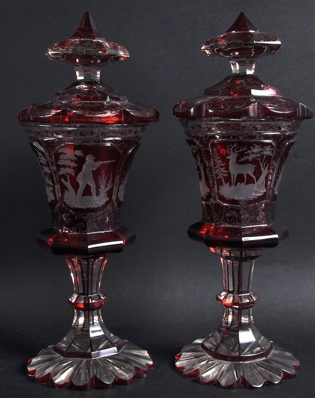 A GOOD PAIR OF BOHEMIAN RUBY GOBLETS AND COVERS etched