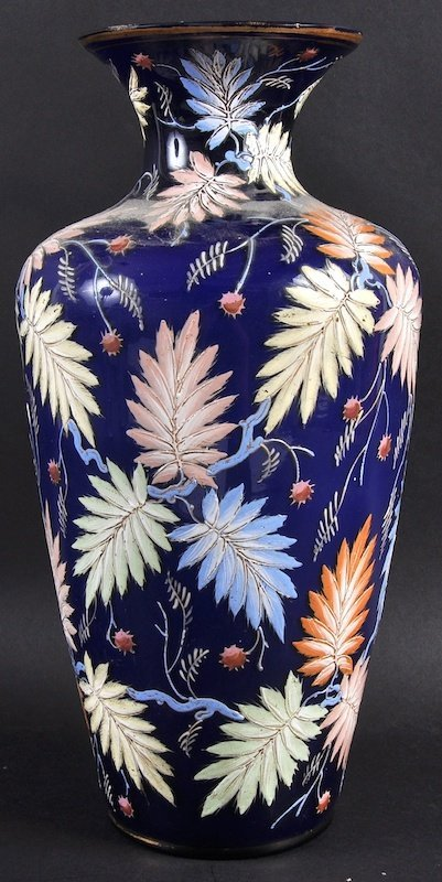 """A """"MOSER"""" BLUE GLASS VASE enamelled with coloured leave"""