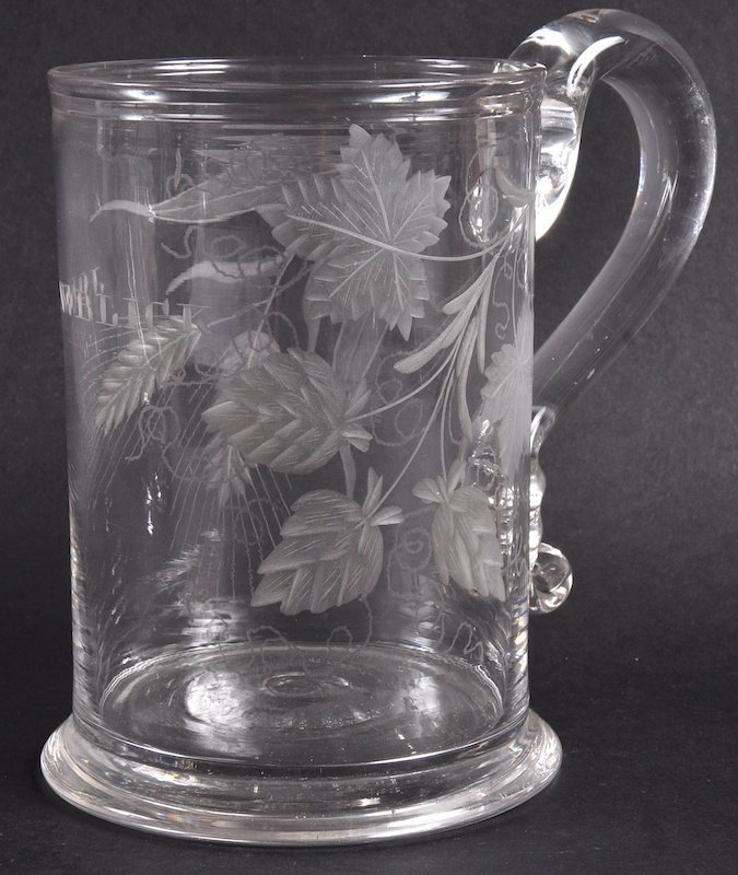 A TANKARD engraved with hops and JOHN & BLICK.