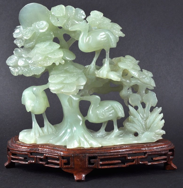 AN EARLY 20TH CENTURY CHINESE CARVED JADE FIGURAL GROUP