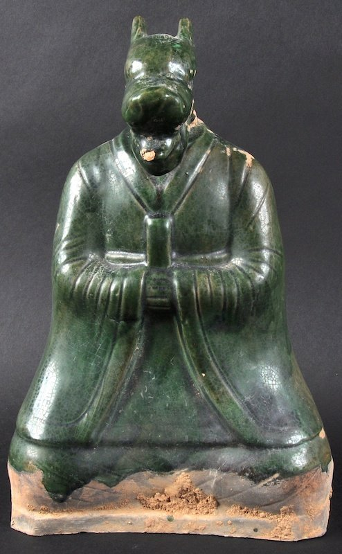A 19TH CENTURY CHINESE GREEN GLAZED FIGURE OF A BEAST
