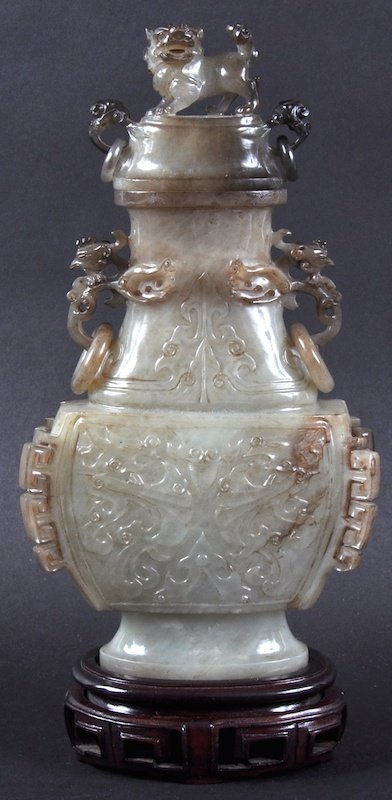 A CHINESE TWIN HANDLE JADE VASE AND COVER Late Qing,