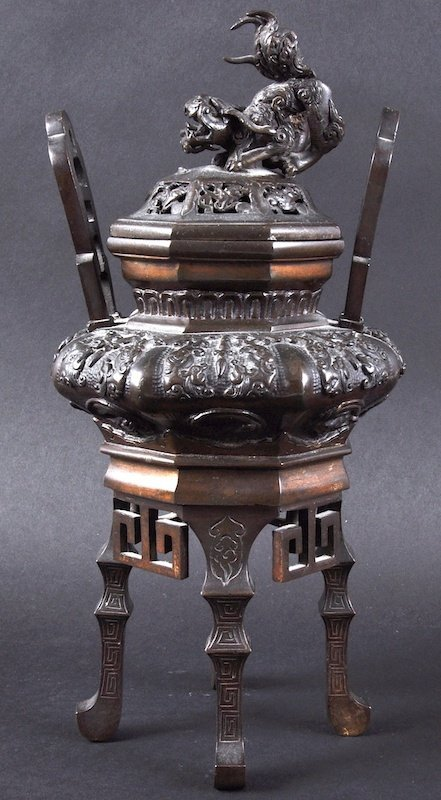 A 19TH CENTURY JAPANESE TWIN HANDLED BRONZE KORO AND