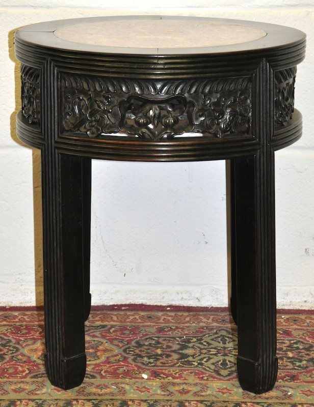 A 19TH CENTURY CHINESE CARVED CIRCULAR HARDWOOD STAND