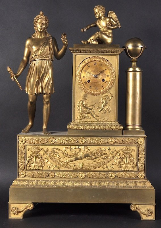 A LARGE EMPIRE ORMOLU CLOCK with circular dial and