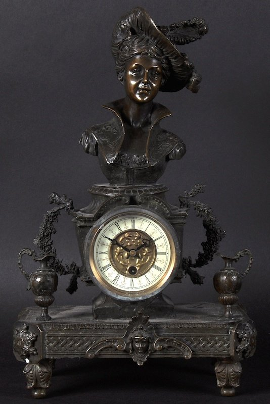 A 19TH CENTURY FRENCH BRONZED CLOCK with female