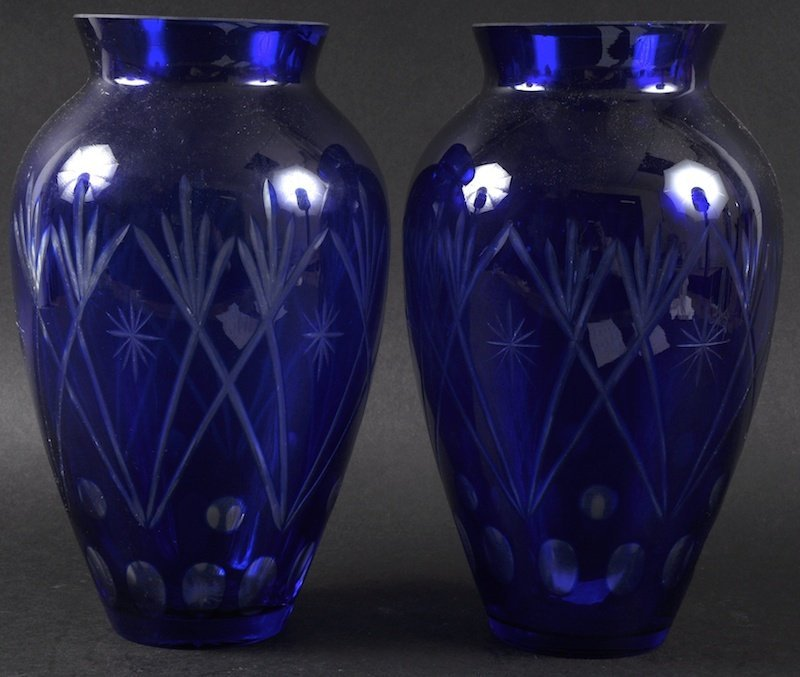 A PAIR OF HEAVY BLUE VASES with slice cut decoration.