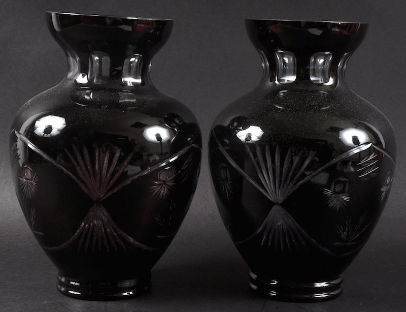 A PAIR OF HEAVY RUBY SLICE CUT VASES.  10ins high.