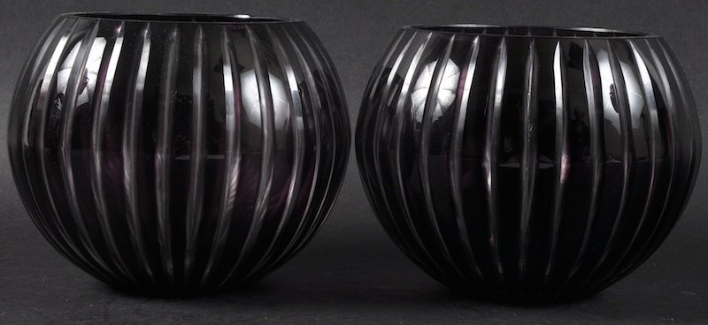 A SMALL PAIR OF SLICE CUT GLOBULAR RUBY VASES.  5.5ins