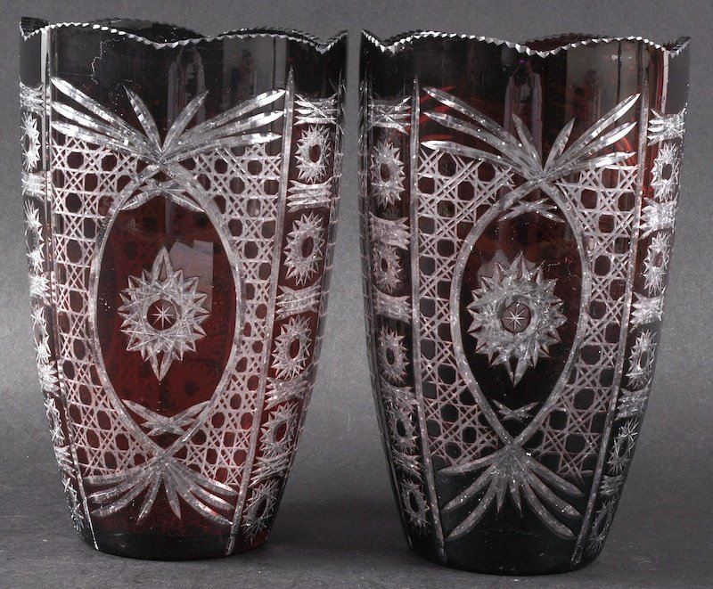 A PAIR OF BOHEMIAN STYLE SLICE CUT VASES.  8.5ins high.