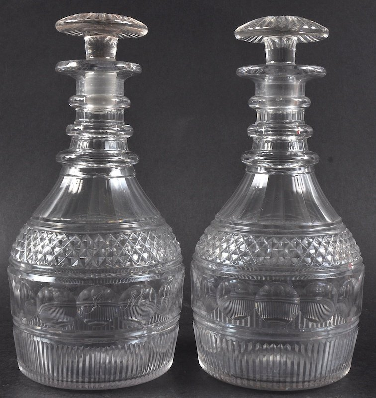 A PAIR OF CUT GLASS MALLET DECANTERS with mushroom