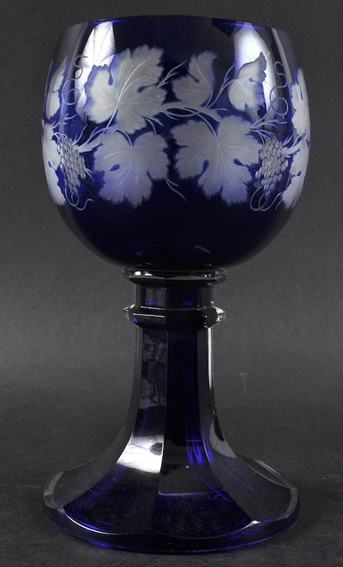 A LARGE BOHEMIAN BLUE GLOBLET engraved with fruiting