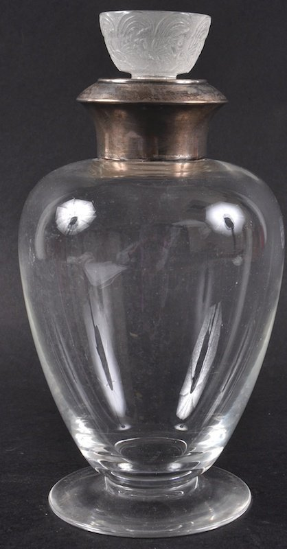 A LALIQUE SILVER TOP PLAIN DECANTER with ornate frosted