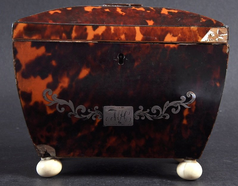 A REGENCY TORTOISESHELL TWO DIVISION TEA CADDY with